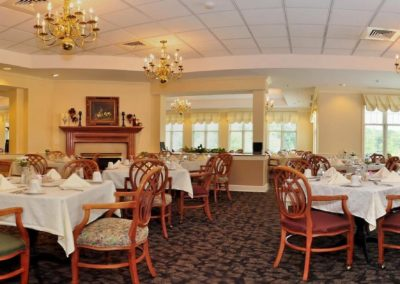Main Dining Room With Tables and Chairs at The Gardens Of Taylor Glen