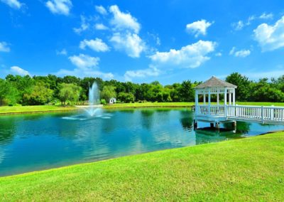 Lake With a Gazebo in the Background at The Gardens Of Taylor Glen